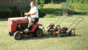 Man on lawnmower