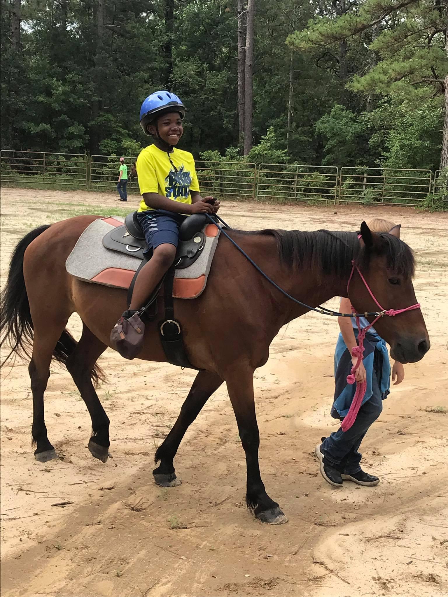 Camper riding horse image